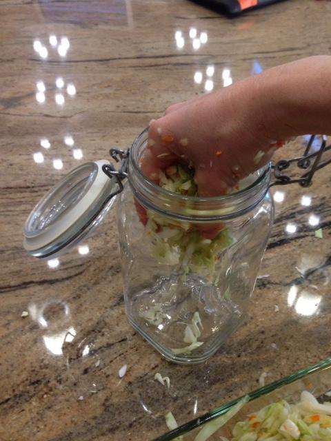 put sauerkraut in jar