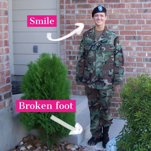 Steph wearing Army uniform and hiding pain behind a smile
